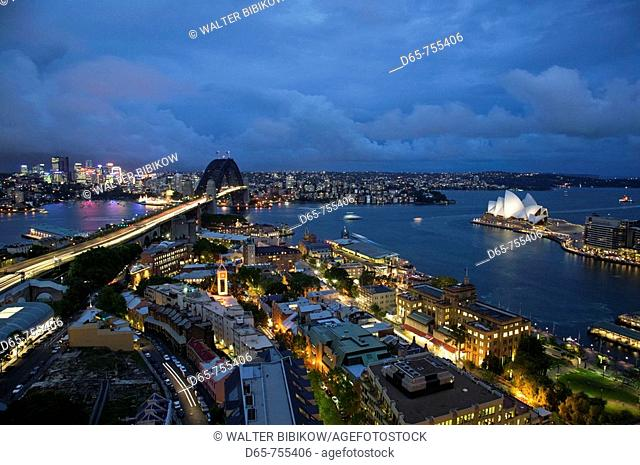 Australia - New South Wales (NSW) - Sydney: Sydney Harbour Bridge and the Sydney Opera House from The Rocks area in the evening