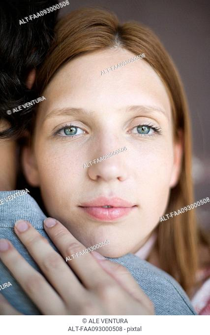 Young woman embracing boyfriend