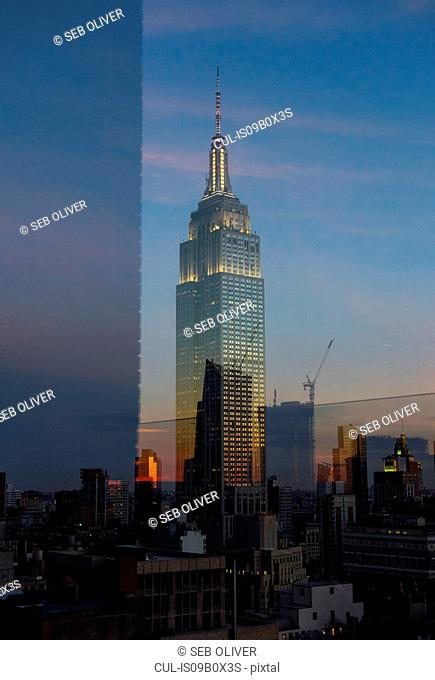 Double exposure of empire state building and skyline at sunset, New York, USA