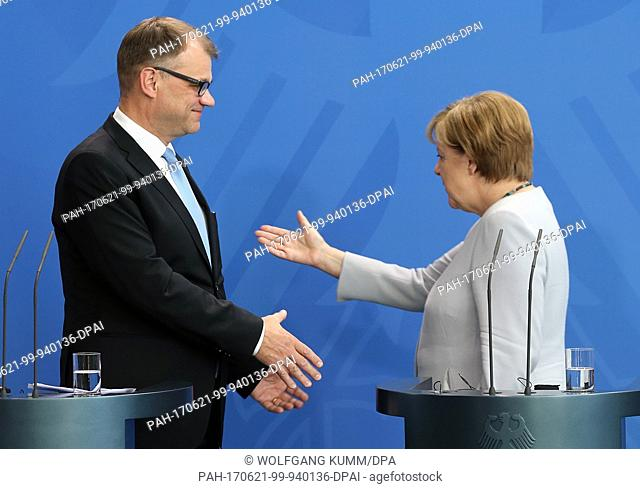 German Chancellor Angela Merkel greets Finnish Prime Minister Juha Sipilä at the Federal Chancellery in Berlin, Germany, 21 June 2017