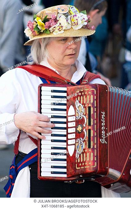 A lady accordionist accompanying the morris dancing at the Oxford Folk festival