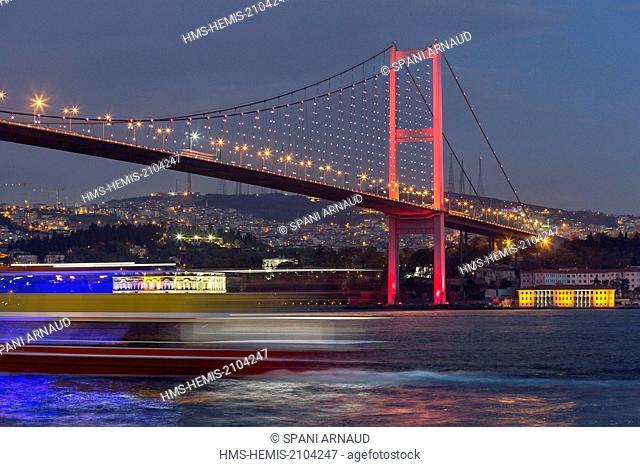 Turkey, Istanbul, Ortakoy district, night view of a suspension bridge over the Bosphorus
