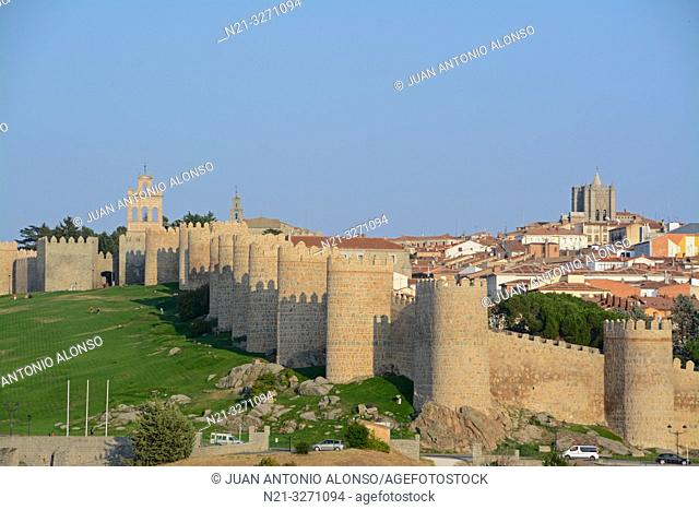 The Espadaña -bell gable- on the left and the Cathedral of Christ the Saviour on the right. The fortified city of Avila, Castilla-Leon, Spain, Europe