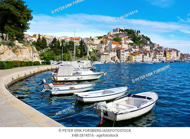 Boats on seaside promenade, with old town in background, Sibenik, Dalmatia, Croatia