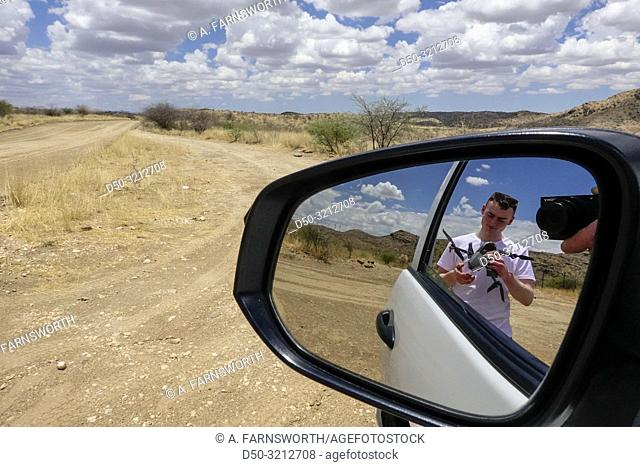 A tourist prepares to fly his drone. Windhoek, Namibia