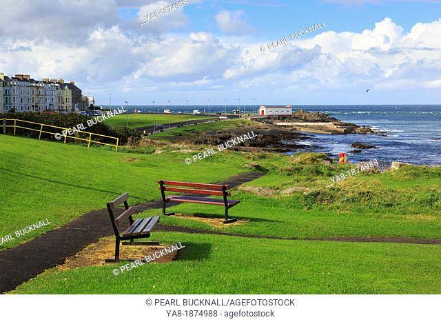 Portrush, County Antrim, Northern Ireland, UK, Europe  Seats on the seafront overlooking the Nature Reserve's rocky shore on the north coast