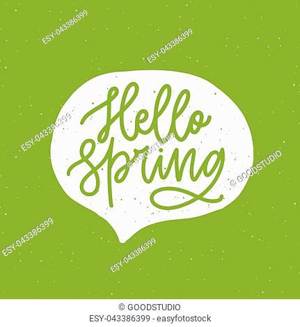 Hello Spring phrase handwritten with elegant cursive font or script inside speech balloon or bubble on green background. Springtime seasonal lettering or...