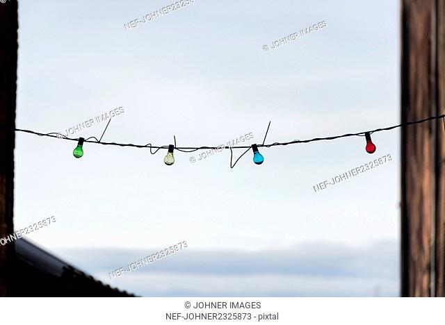 Lightbulbs hanging on cord