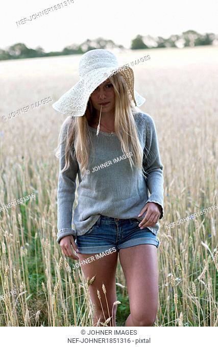 Teenage girl on wheat field