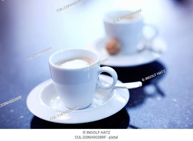 Espresso cups on office desk
