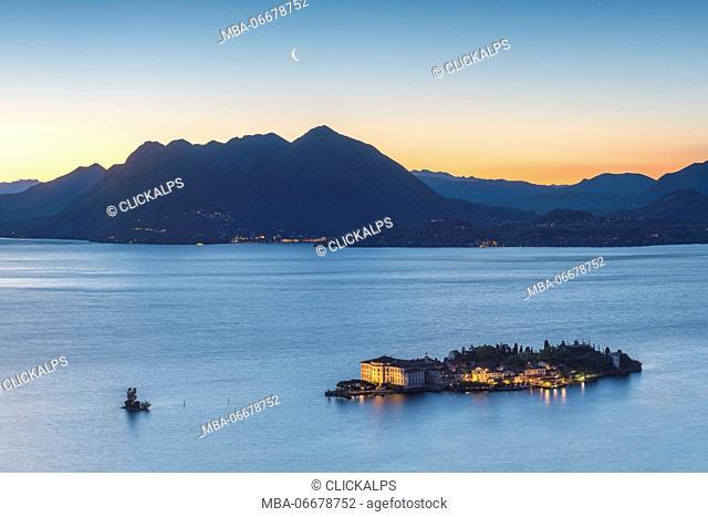 Borromean Islands, Stresa, Lake Maggiore, Verbano-Cusio-Ossola, Piedmont, Italy. Isola Bella at dawn with moon