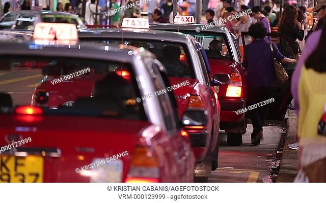 People entering a taxi and taxi moving away, Taxi queue, Hong Kong, China, Asia