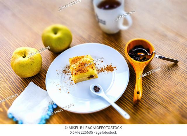 Couscous and stewed apples cake, with cinnamon and raisins. Macrobiotic recipe