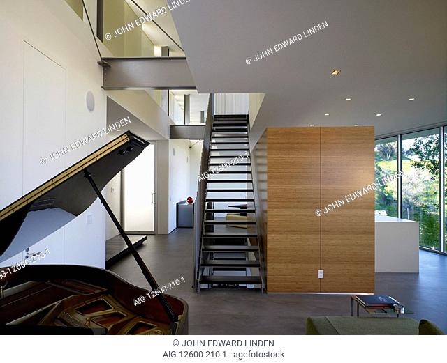 Grand piano in double height open plan entrance hall of Briarcrest House, Beverly Hills, California, USA