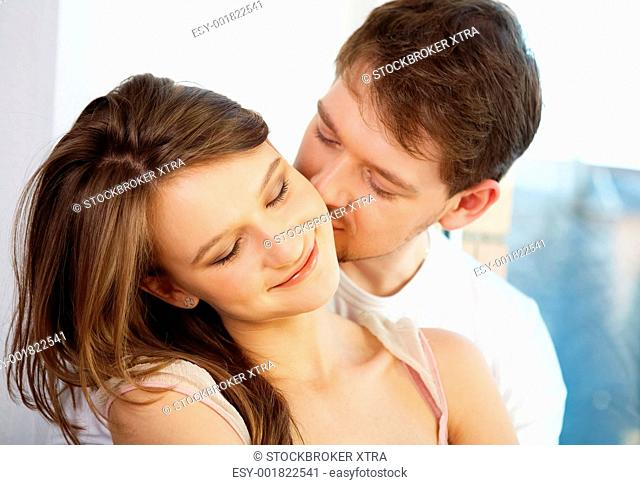 Pretty woman has pleasure from male kisses
