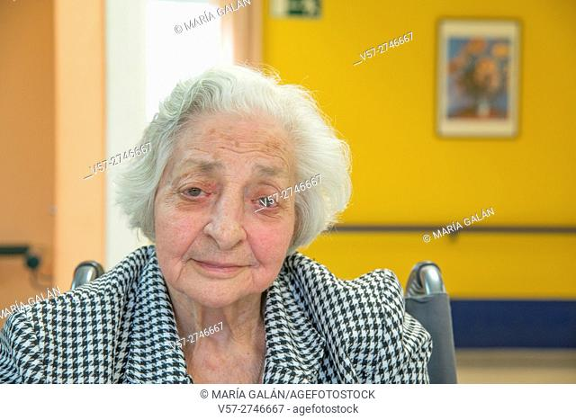 Portrait of elderly woman in a nursing home, looking at the camera