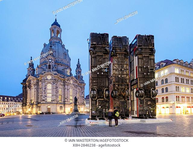 Sculpture of 3 vertical buses symbolising anti sniper barricade in Aleppo by Syrian-German artist Manaf Halbouni in Dresden, Germany