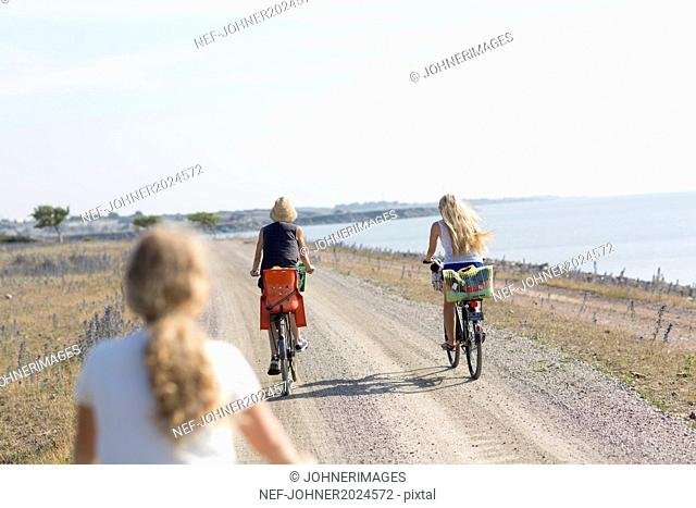 Mother with two daughters cycling