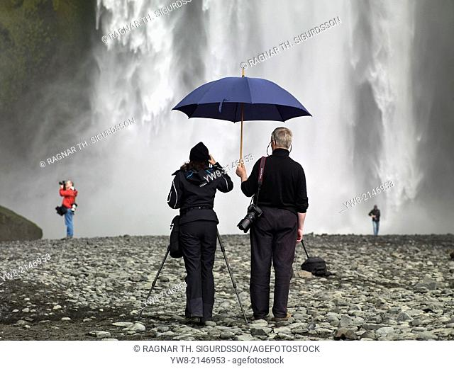 Taking pictures at Skogafoss Waterfalls, Iceland