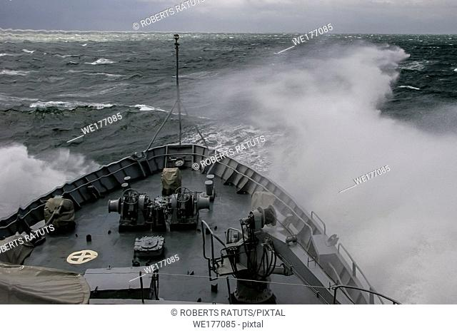 Ship in sea storm. Storm at Baltic sea. Warship training in the Baltic Sea during a storm. NATO military ship in Baltic sea, Latvia