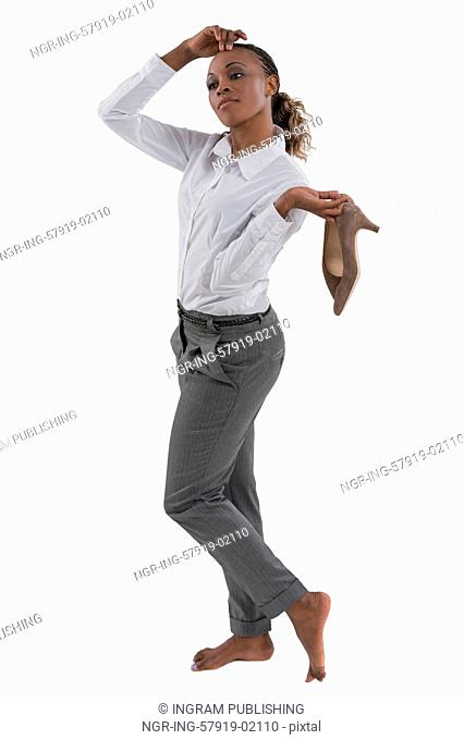 African business woman taking off shoes isolated on white background