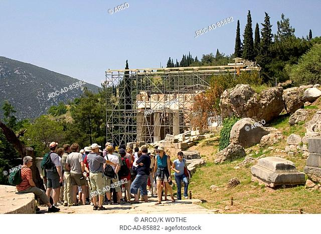 Tourist group at reconstruction works at treasure house of the athenians Delphi Greece