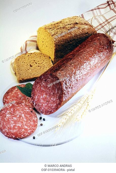 salami and a sliced bread on a plate