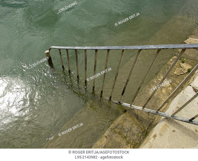 Stairs going into the Ebro river in Spring at high water level, Miravet, Spain