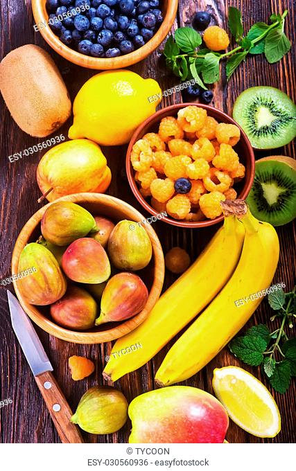fresh fruit on the wooden table, autumn fruits