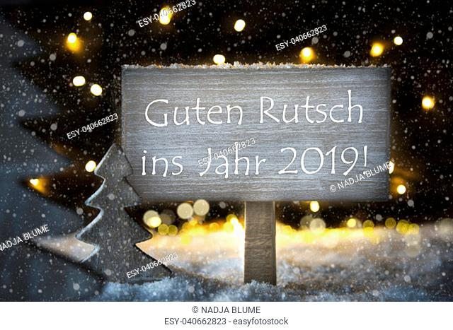 Sign With German Text Guten Rutsch 2019 Means Happy New Year 2019. White Christmas Tree With Snow And Magic Glowing Lights In Backround And Snowflakes