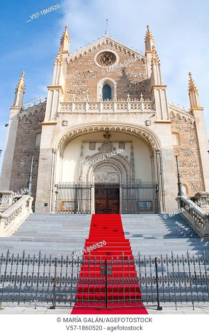 Facade of San Jeronimo El Real church with red carpet. Madrid, Spain