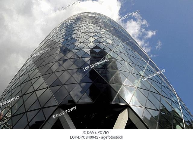 England, London, City of London, View looking up at 30 St Mary Axe, also known as the Gherkin, the second tallest building in the City of London