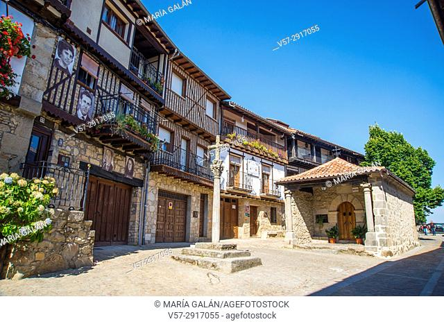 Street and stone cross. Mogarraz, Sierra de Francia Nature Reserve, Salamanca province, Castilla Leon, Spain