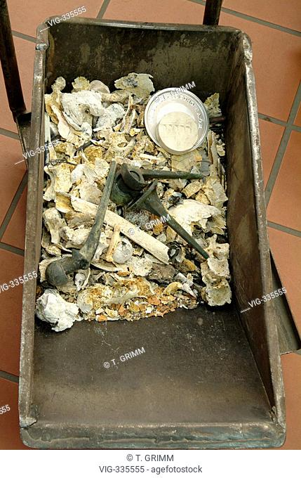 Cremation in Hamburg crematorium on the cemetery Hamburg Oejendorf. The picture shows the remaining human ashes with a numbered identification stone and...