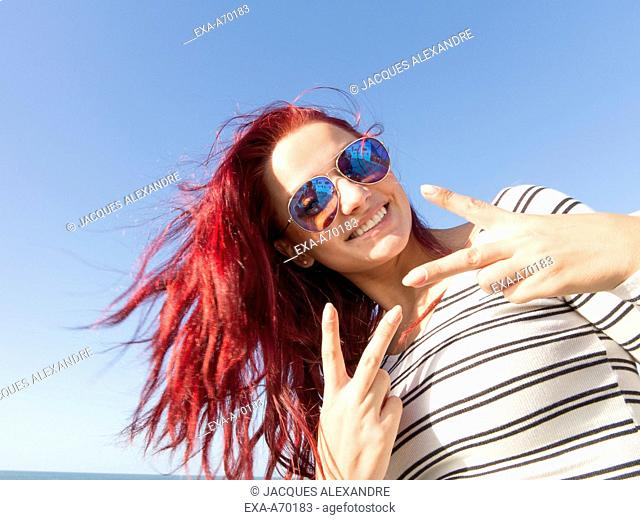 teenager victory sign