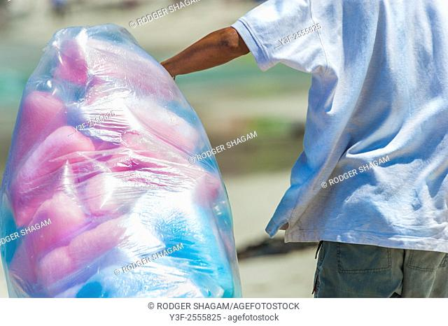 Selling candy floss cotton candy at the beach. Muizenberg Beach, Cape Town, South Africa