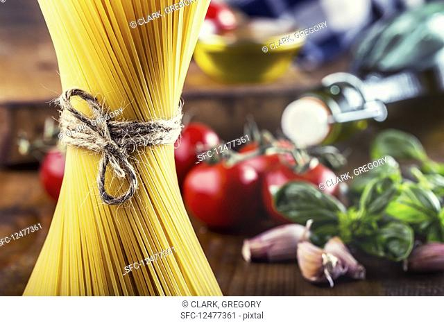 Spaghetti and some ingredients of Italian cuisine