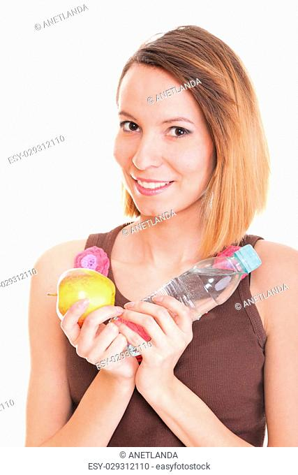 Beautiful girl drinking water from blue bottle red apple isolated on white background