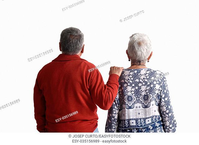Couple looking back to horizon