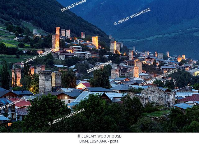 Illuminated valley town at night, Mestia, Georgia