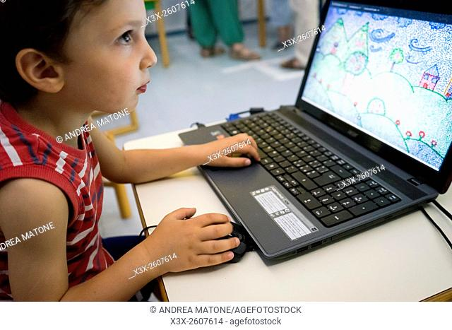 Child playing with a laptop computer