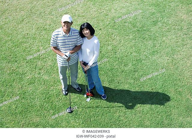 Elevated view of a couple with golf club