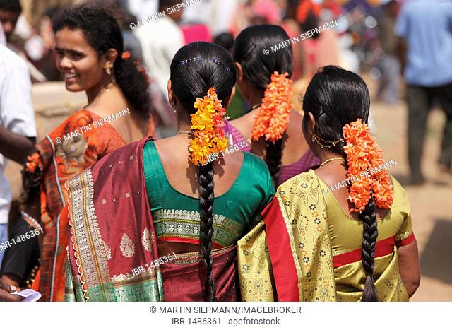 Women with flowers in their hair, festival south of Hunsur, Karnataka, South India, India, South Asia, Asia