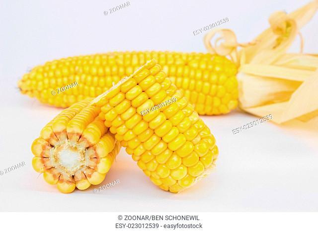Whole and halve corncobs