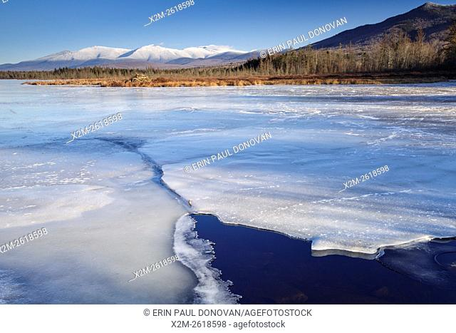 Snowcapped Presidential Range from Cherry Pond at Pondicherry Wildlife Refuge in Jefferson, New Hampshire USA. The Presidential Range Rail Trail (Cohos Trail)...