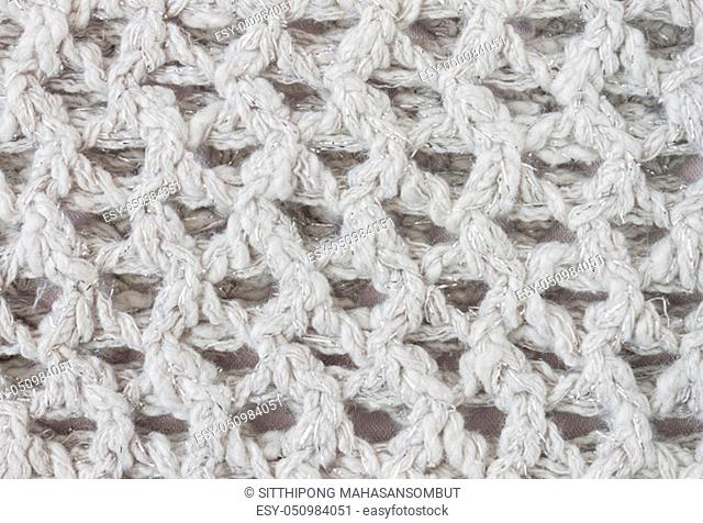 White Knitting Texture or Knitted Texture Background in macro style. Knitting Texture or Knitted Texture in vintage style for design