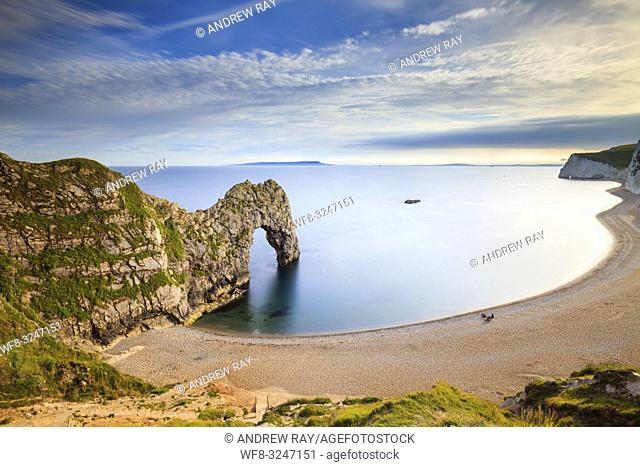 Durdle Door natural sea arch on Dorset's Jurassic Coast , captured from a high vantage point on an evening in early July using a long shutter speed