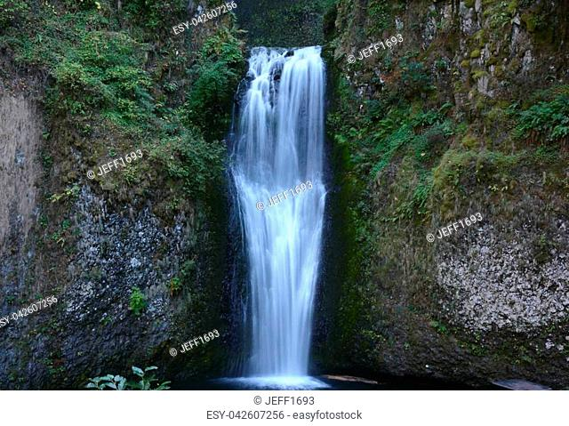 Showing a shaded view of lower Multnomah Falls, in the Columbia River Gorge National Scenic Area of northern Oregon