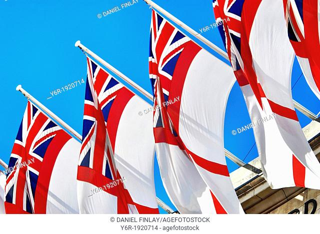 British Royal Navy flags hanging from Admiralty Arch in central London, on the edge of Trafalgar Square, on a sunny Summer day in England