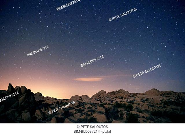 Stars in sky over desert